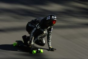 Mischo Erban races down the hill during a speedboarding practice run on Mount Panorama in Bathurst, Australia.