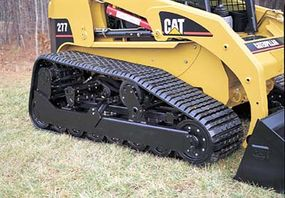 The track configuration of the Caterpillar Multi Terrain Loader transfers machine weight to the ground through 48 wheeled contact points.