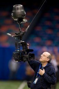 A technician inspects a Skycam before an event.