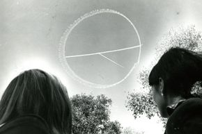 Most of a skywritten peace symbol floats in the sky over Boston Common during a peace rally held on Oct. 15, 1969.