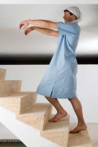 Person sleepwalking up stairs