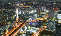 In this shot of Yokohoma at night, the use of slow shutter speed captures the accumulated light of street traffic and turns the roadways into rivers of illumination.
