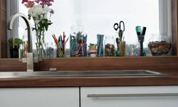 An over-the-sink-shelf could hold a lot of kitchen equipment.