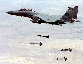 An F-15 Strike Eagle drops GBU-12 laser-guided smart bombs.