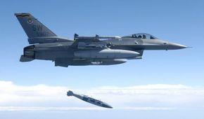 An F-16 drops a JDAM-equipped GBU-31 2,000-pound bomb.