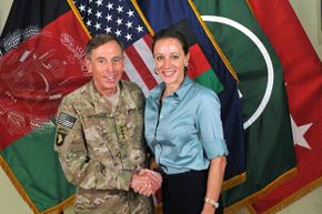 CIA director Gen. Davis Petraeus poses with his biographer Paula Broadwell, with whom  he had an extra-marital affair that was discovered through an e-mail trail. See more historical couples pictures.