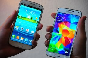 A Samsung Galaxy S5 (R) compared in size to a Galaxy S3 device. The S5 is significantly larger than its generation 3 predecessor. The new Galaxy S5 is the largest of the series and around 3 millimeters wider, 5 millimeters longer, and a fraction thicker than its predecessor. See more cell phone pictures.