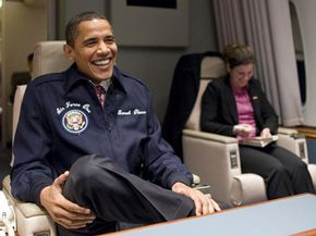 President Obama gives a winning smile aboard Air Force One.