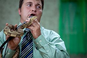 Pastor Mack Wolford, a member of the Pentecostal 'Signs Following' tradition, handles a rattlesnake during a service at the Church of the Lord Jesus in Jolo, West Virginia, on Sept. 2, 2011. Wolford would die the following year from a rattlesnake bite.