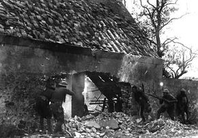 American snipers of the 166th Infantry exchange fire with German snipers on the outskirts of Villers de Fere, France, July 30, 1918.