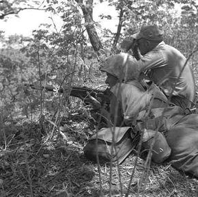 A U.S. Marine Corps sniper team at work in the Korean War.