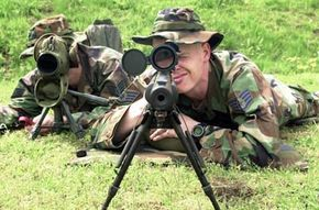 Snipers practice marksmanship on a range at the U.S. Army Sniper School at the Sembach Army Annex in Germany.