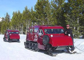 These snowcoaches illustrate some of the similarities between snowmobiles and tanks. They're essentially multi-passenger snowmobiles, with a steering wheel instead of handlebars.