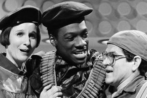 """Pictured: Mary Gross, Eddie Murphy and Tim Kazurinsky in a 1982 """"Saturday Night Live"""" skit titled """"Herpes Gone Bananas."""""""