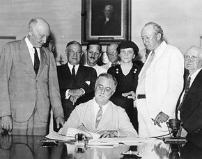 President Roosevelt signing the Social Security Act of 1935