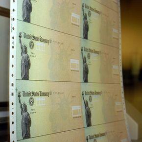 Social Security benefit checks run through a printer at a U.S. Treasury facility in Philadelphia, Penn.