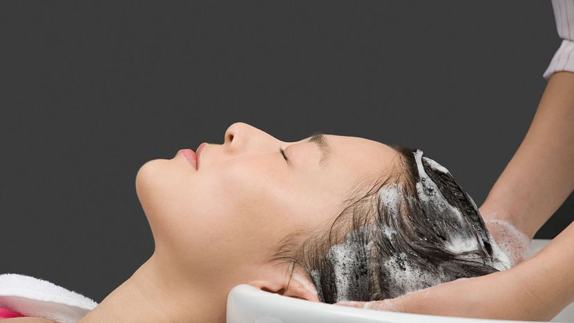 woman getting shampoo