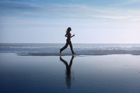 Running close to the shore, where the sand is damp, can give you a good workout.