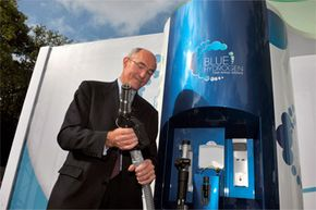 Air Liquide CEO Benoit Potier demonstrates his enthusiasm for the hydrogen economy as he tries out a hydrogen filling station near Paris in 2011. Could solar energy help out with hydrogen production?