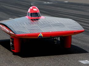 The dimensions of a competitive solar-powered race car are not those of a typical vehicle. This World Solar Challenge car, named Tiga, is the entry from the Ashiya University in Japan.