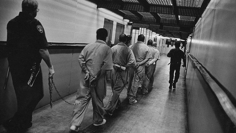 Prisoners are escorted down a hallway in Pelican Bay prison. A study on Pelican Bay found solitary confinement caused a host of psychiatric problems like hallucinations, panic attacks, paranoia, as well as high rates of suicide. Andrew Lichtenstein/Corbis via Getty Images