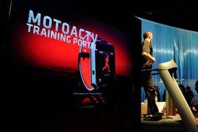 Fitness trainers demonstrate Motorola's MotoACTV at the 2012 International Consumer Electronics Show in Las Vegas.