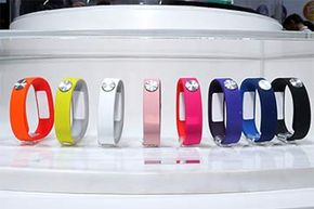Sony SmartBands in various colors (with the Core in the middle) stand on display at the Sony Corp. pavilion during the Mobile World Congress in Barcelona, Spain in 2014.