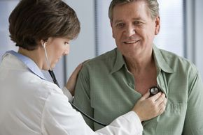 What is this doctor hearing as she listens to this man's heart? Lub-dub? Lub-dub-whoosh? Or is it some unique variation?