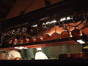 To maintain cleanliness, sous chefs may have their staff wash all of these pots each night -- used or not.