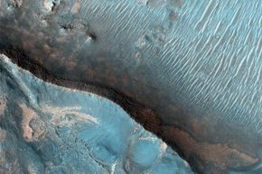 The Nili Fossae region of Mars is one of the largest exposures of clay minerals discovered by the OMEGA spectrometer on the Mars Express mission.