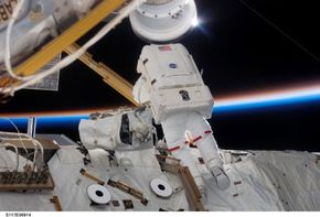 Photo courtesy NASA Astronaut Jim Reilly, an STS-117 mission specialist with the crew of space shuttle Atlantis, aids with repairs on the International Space Station. See more NASA pictures.