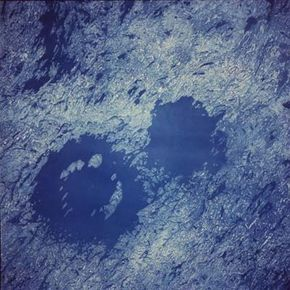 A satellite photo of twin craters at Clearwater Lakes in Northern Quebec, possibly formed by the simultaneous impact of two asteroids. Could life on Earth survive a large impact?