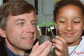Canadian astronaut Bob Thirsk examines some tomato seedlings grown by schoolkids from seeds taken into space. Thirsk's vision deteriorated so much aboard the International Space Station, he had to ask for help focusing cameras.