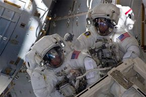 NASA astronauts Andrew Feustel (R) and Michael Fincke are pictured during the STS-134 mission's third spacewalk in 2011. Astronauts are carefully monitored for signs of mental stress while on space missions.