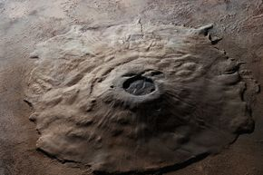 You just can't tell from that shot of Olympus Mons how very sprawling the Martian volcano is. You have to see it to believe it.