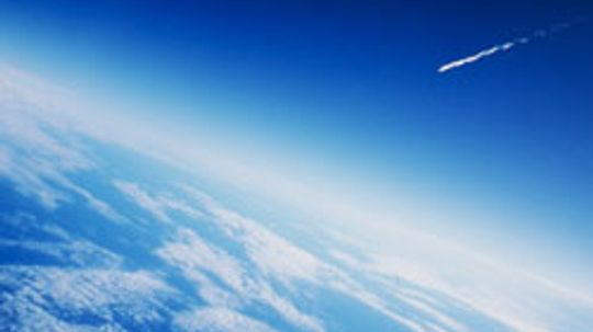 How do spacecraft re-enter the Earth's atmosphere?