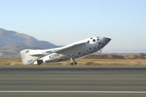 Shown just before touchdown at 90 mph (145 kph), SpaceShipOne returns to the runway.