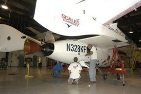 SpaceShipOne undergoes preflight inspection before its historic June space flight.