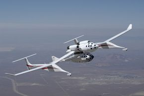 The White Knight turbojet aircraft climbs over the Mojave desert with SpaceShipOne attached to its underbelly. See more space exploration pictures.