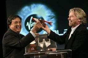 New Mexico Gov. Bill Richardson and Richard Branson of Virgin celebrate the partnership of Spaceport America and Virgin Galactic.