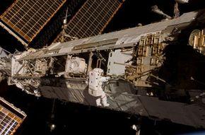 Astronaut Daniel Tani working on the International Space Station.