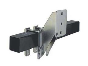 This spare tire mount is designed to clamp onto the framework of a trailer tongue.
