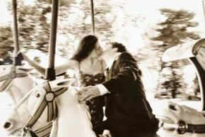 If you've always dreamed of sharing a kiss on a carousel (and having the moment immortalized), book a photographer who can take you to the nearest theme park instead of the studio.