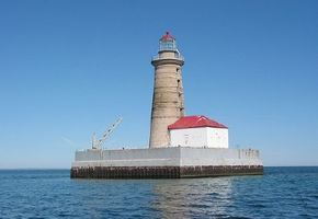 The Spectacle Reef lighthouse stands 95 feet tall and is located on a submerged reef about 11 miles east of the Straits of Lake Huron. See more lighthouse pictures.