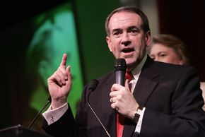 Republican candidate Mike Huckabee, shown on Super Tuesday 2008, faced blame for push poll calls that favored him.