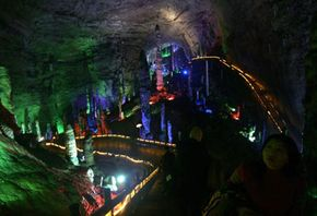 Chinese tourists take a tour of Asia's largest cave, Huanglong (Yellow Dragon) Cave in Zhangjiajie, China. Tours like these are great ways to learn more about caving.