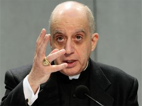 """Monsignor Rino Fisichella, who heads the Pontifical Academy for Life, gestures during a press conference at the Vatican on Feb. 17, 2009. The Vatican is warning of the """"relentless'' spread of a eugenics mentality with the advance of genetic testing."""