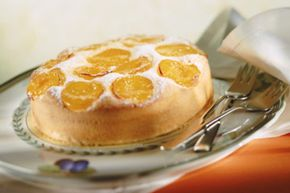 Try topping your cake with an interesting fruit like apricot.