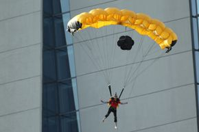 A BASE jumper steers his parachute after launching off the sky park at Marina Bay Sands in Singapore.