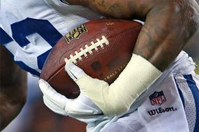 After intercepting a second quarter pass by New England quarterback Tom Brady, Indianapolis Colts linebacker D'Qwell Jackson runs with the ball that sparked the controversy over the charges that the Patriots were using underinflated footballs.